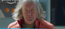 James May looks petrified as he meets giant robot.